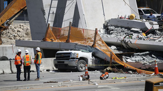 Worker hurt in bridge collapse thinks locking in harness saved his life, cousin says