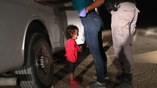 Photographer details the emotional moment that created viral border photo of crying toddler