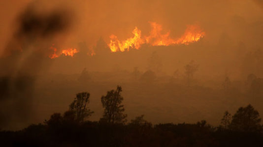 Police arrest suspect linked to raging wildfire in California