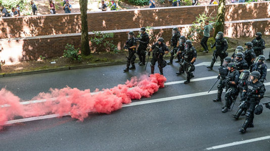 Portland protesters clash with police, each other in dueling rallies
