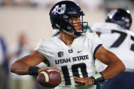 Love has big first half, Utah State defeats New Mexico 61-19