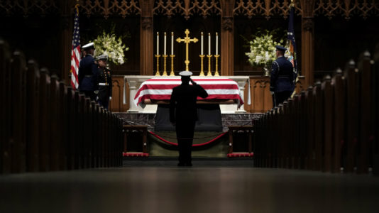 Mourners line tracks as funeral train carries President George H.W. Bush to burial next to wife, daughter